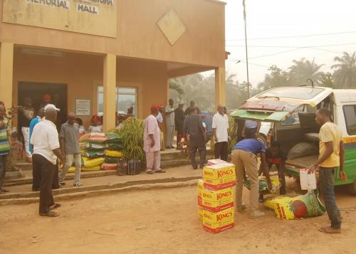 DONATED ITEMS BEING OFFLOADED IN FRONT OF THE COMMUNITY HALL BUILT BY THE FOUNDATION