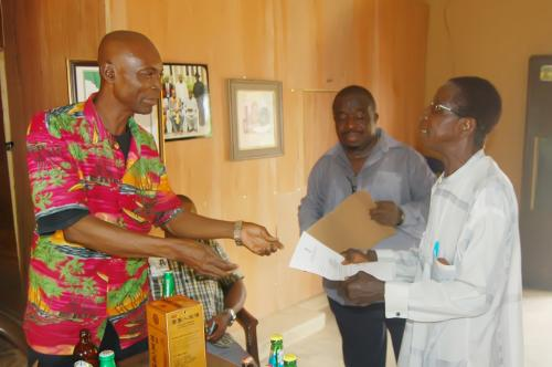 Ndiucheagwu Community head returning their delivery note after acknowledgement.
