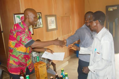 Mr. Goddy Obioha exchanging pleasantries with Ndiucheagwu Community head and patron after the presentation.