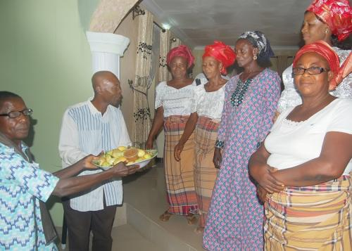AFTER THE PRESENTATION OF KOLA NUTS BY THE WOMEN EXECUTIVES AMONG THEM SOME WIDOWS