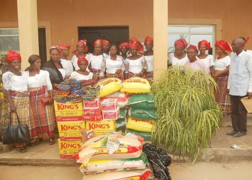 COMMUNITY WOMEN REPRESENTATIVES WITH DONATED ITEMS