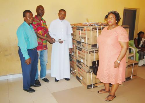 Official presentation of the list of items donated by the foundation to Rev. Igbokwu of St Mark's church Arondizuogu.