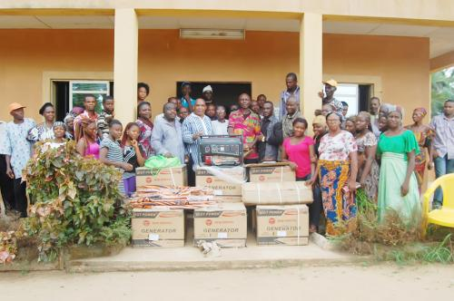 The Ndiucheagwu community in a happy mood with the donated items in front of their community Hall which was constructed and equified by the Adure and Onyina Obioha foundation.
