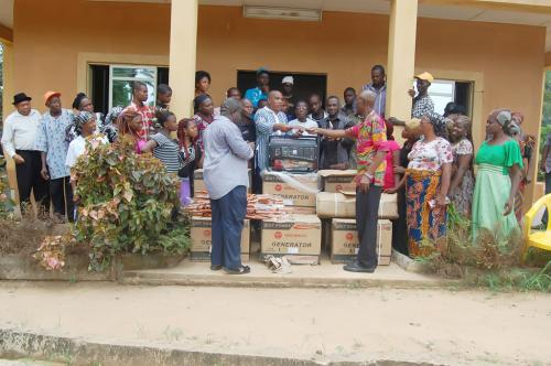 The official presentation of generators, umbrella and torchlights to  Ndiuche Agwu community at their community hall by a representative of the Adure and Onyima Obioha Foundation.