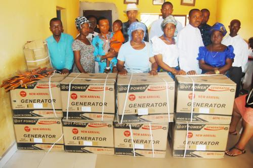 A section of members of St Marks Anglican Church Arondizogu with the generators, umbrellas and torch light donated to the church by Adure and Onyima Obioha foundation.