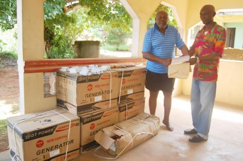 Dr. Mazi Ekweanuo receiving generators, umbrellas and torch lights donated to the Obioha Family by the Adure and Onyima Obioha Foundation.