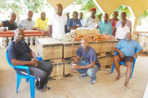 A cross section of members of Obioha family with items donated by the Adure and Onyima Obioha Foundation during the Easter season.