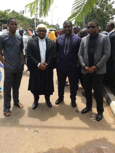 Barrister E.C Iphie with his older brother and friends