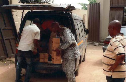 Foundation representatives offloading gifts at Parish premises