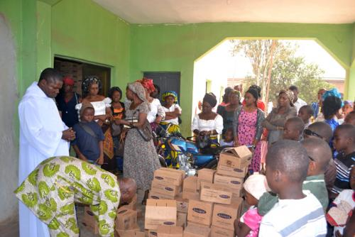 Parishioners recieving gifts from the Foundation