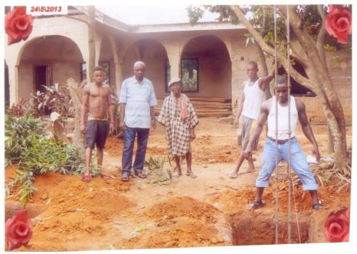 Mazi Osu and workers at the construction site